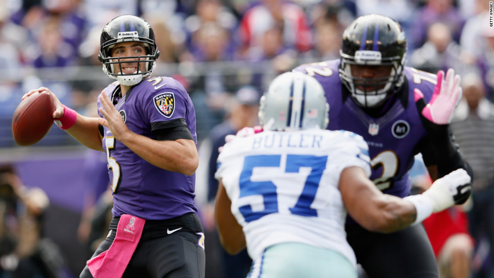Quarterback Joe Flacco of the Baltimore Ravens drops back to pass against the Dallas Cowboys on Sunday at M&T Bank Stadium in Baltimore.