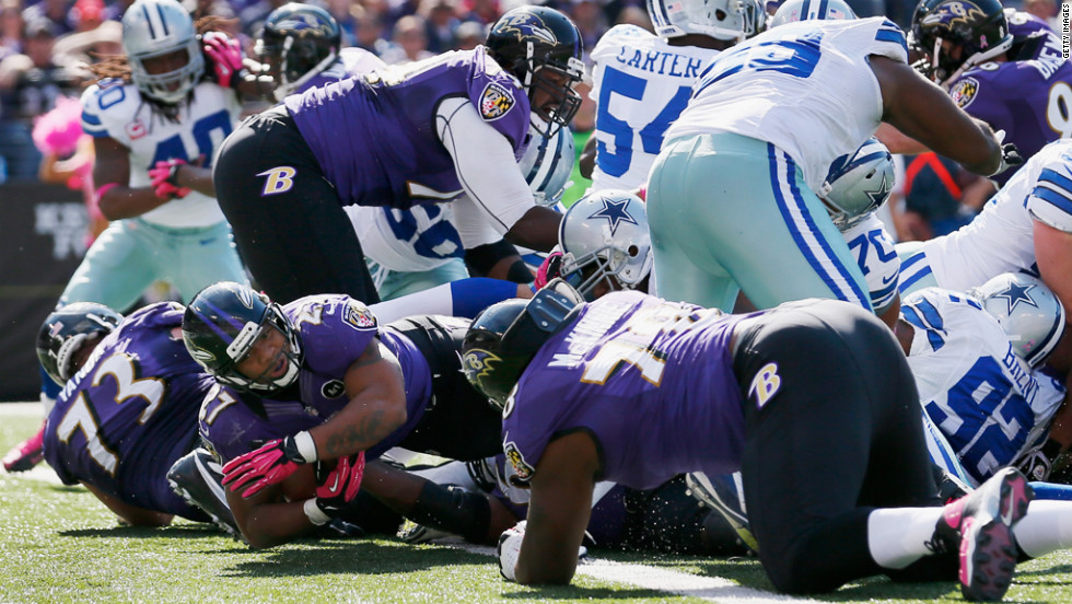 Running back Ray Rice of the Ravens rushes for a touchdown against the Cowboys.