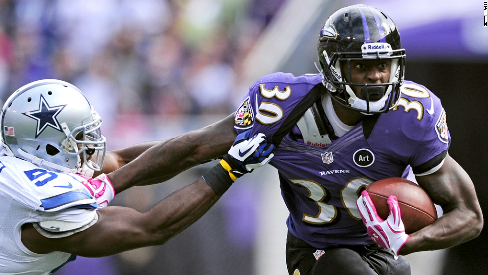 Bernard Pierce of the Ravens tries to break a tackle on Sunday.