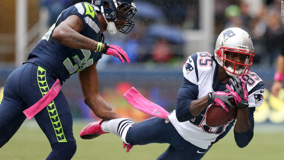 Brandon Lloyd of the New England Patriots makes a catch against Brandon Browner of the Seattle Seahawks.
