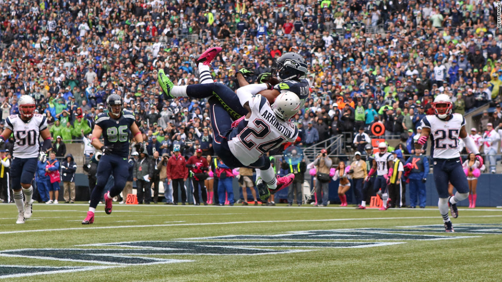 Doug Baldwin of the Seattle Seahawks makes a touchdown reception against Kyle Arrington of the New England Patriots on Sunday.