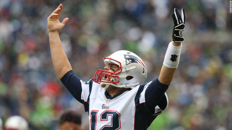 New England's Tom Brady celebrates after throwing a touchdown pass in the first half against Seattle.