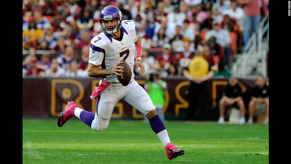 Vikings quarterback Christian Ponder scrambles with the ball during Sunday's game against the Redskins.