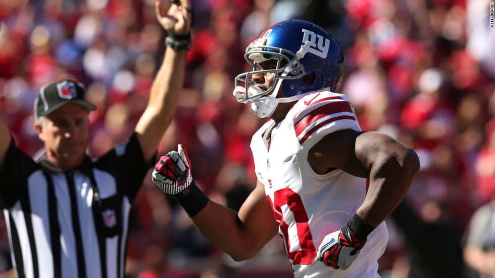 Victor Cruz of the New York Giants dances after making a six-yard touchdown catch in the second quarter against the San Francisco 49ers.