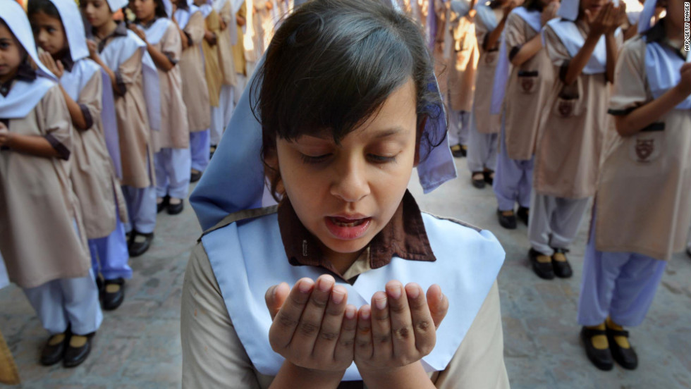 Pakistani school girls pray for the recovery of teen activist Malala Yousufzai at their school in Peshawar.