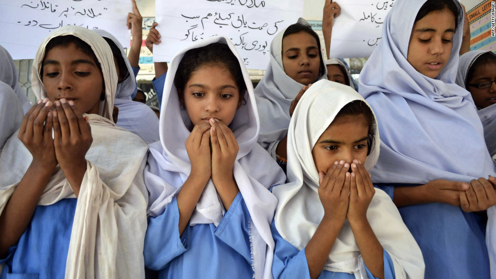 "Pakistani school girls pray for the Malala's recovery. Over the weekend, the teen moved her limbs after doctors ""reduced sedation to make a clinical assessment,"" military spokesman Maj. Gen. Asim Bajwa said."