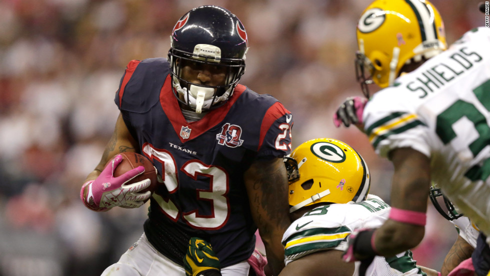 Arian Foster of the Houston Texans is tackled by C.J. Wilson of the Green Bay Packers on Sunday, October, 14, at Reliant Stadium in Houston.