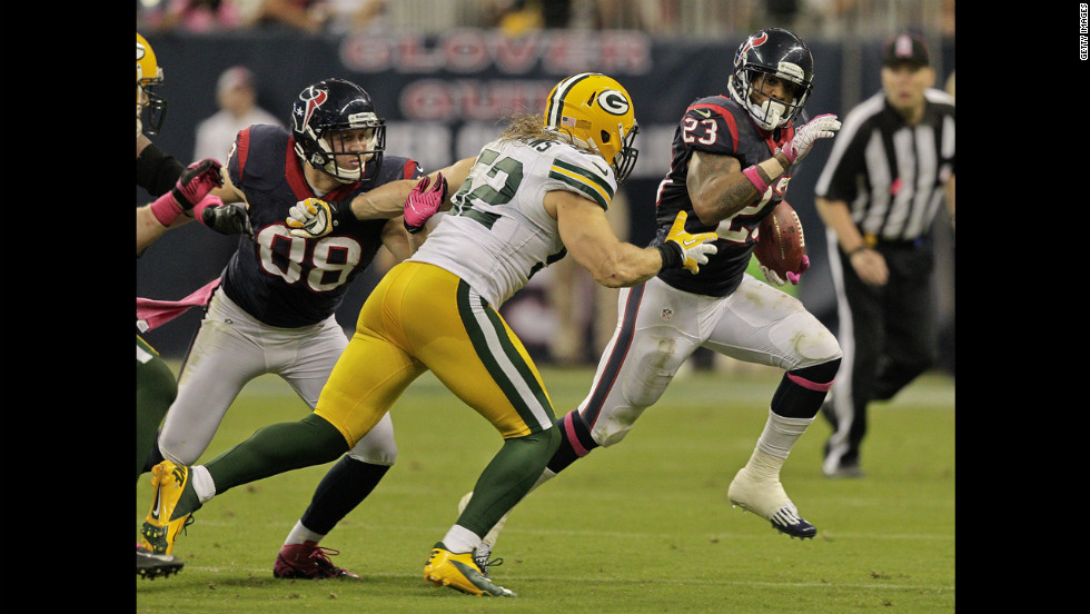 Houston's Arian Foster looks for room to run as he is pursued by Clay Matthews of Green Bay.
