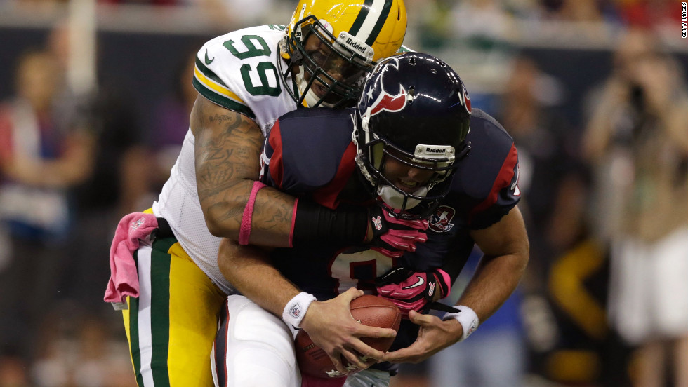 Jerel Worthy of the Green Bay Packers sacks Houston Texans quarterback Matt Schaub in the first quarter.