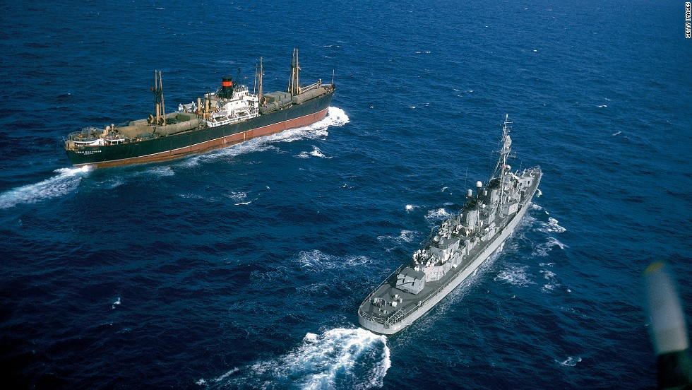 American destroyer USS Vesole (DD-878) escorts the Russian freighter Polzunov into international waters, bringing an end to the Cuban missile crisis in October 1962.
