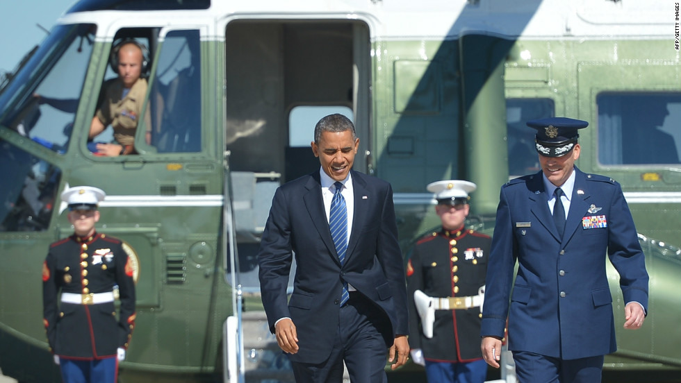 Obama is more often seen on the campaign trial in a suit, as seen here on his way to  a campaign rally in Miami, Florida. For a more casual look, he often loses the jacket and rolls up his sleeves.