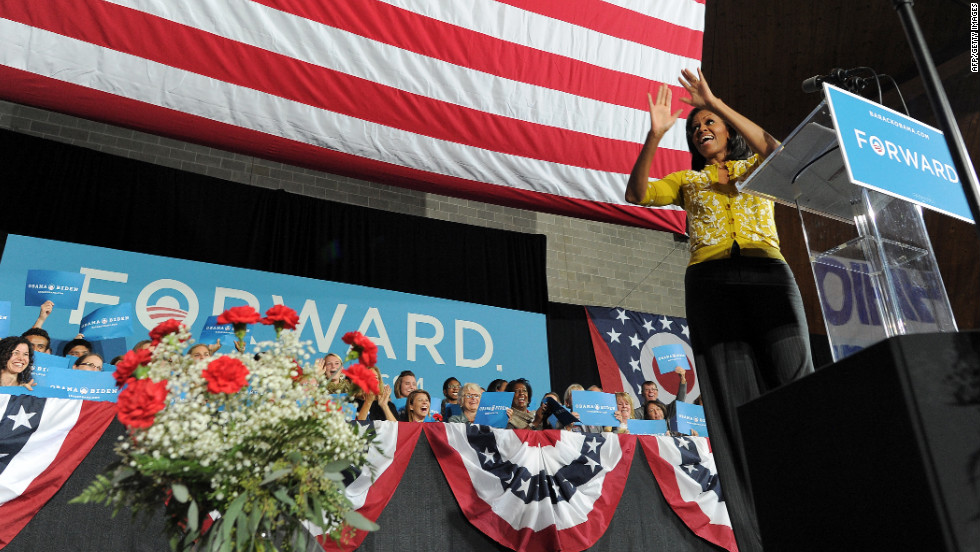 First lady Michelle Obama greets supporters during a campaign rally at Ohio Wesleyan University in Delaware, Ohio, on Monday, October 15.