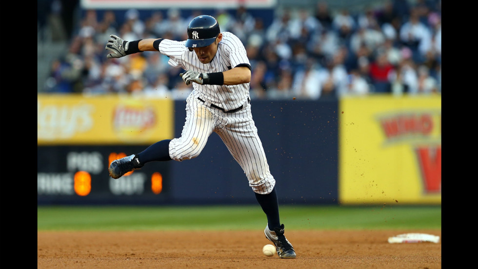 Ichiro Suzuki of the New York Yankees avoids a ground ball hit by teammate Mark Teixeira in the sixth inning.