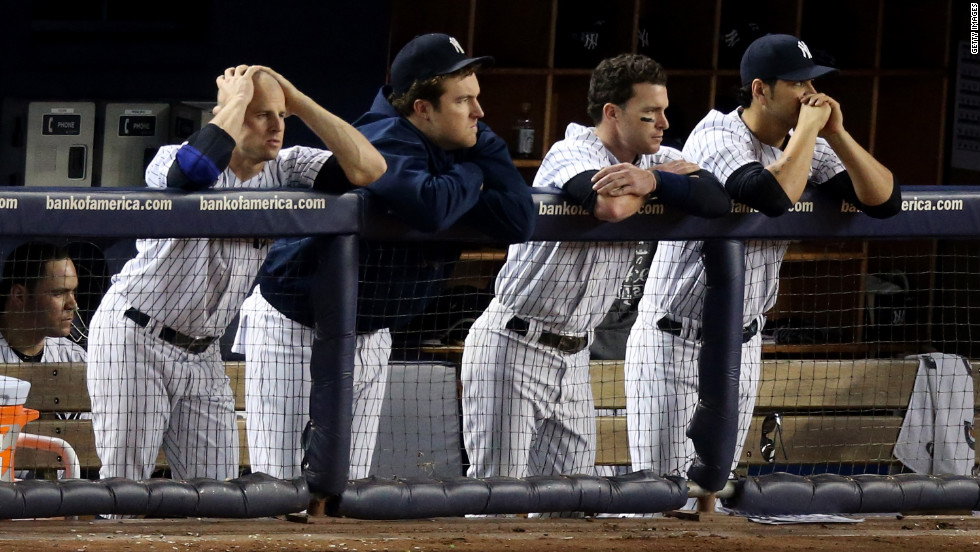 The New York Yankees look dejected in the ninth inning.