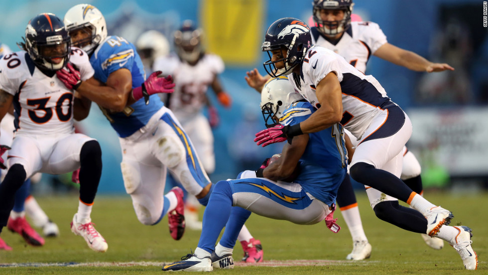 Matt Willis of the Denver Broncos, right, tackles Eddie Royal of the San Diego Chargers.