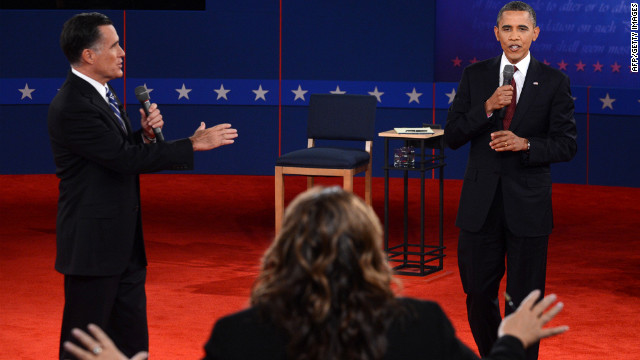 CNN's Candy Crowley (C) conducts the second presidential debate with US President Barack Obama  (R) and Republican presidential candidate Mitt Romney (L) at the David Mack Center at Hofstra University in Hempstead, New York, October 16, 2012.      AFP PHOTO / Saul LOEB        (Photo credit should read SAUL LOEB/AFP/Getty Images)
