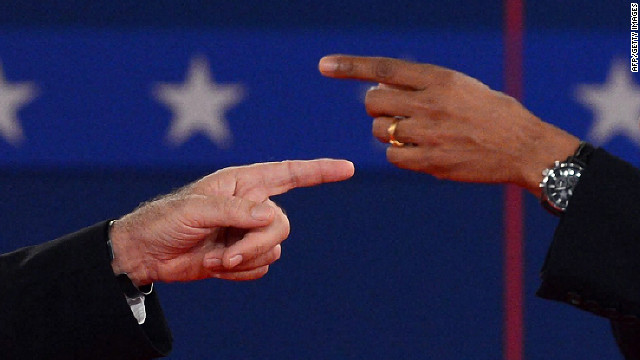 US President Barack Obama and Republican presidential candidate Mitt Romney point the finger at each other during the second presidential debate, the only held in a townhall format, at Hofstra University in Hempstead, New York, on Tuesday, October 16, moderated by CNN's Candy Crowley.
