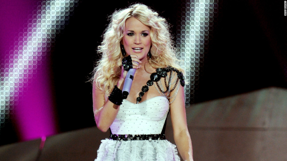 "When Carrie Underwood's <a href=""http://www.cnn.com/video/#/video/us/2012/09/25/carrie-underwood-first-kiss.cunews4fans"" target=""_blank"">not making the dreams of a young boy come true with a quick kiss</a>, she's knocking out No. 1 albums, <a href=""http://www.cnn.com/2012/05/09/showbiz/music/carrie-underwood-top-billboard-album-ew/index.html?iref=allsearch"" target=""_blank"">as she did this year with ""Blown Away."" </a>"