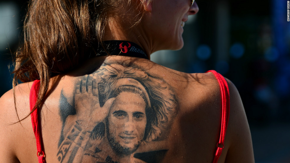 As MotoGP returns to Malaysia for the first time since the tragic death of Marco Simoncelli, the Italian's memory is very much to the fore of the sport. Here, a fan of the rider, shows her devotion with a tattoo in tribute to her hero who died following a fatal crash on October 23 2011.