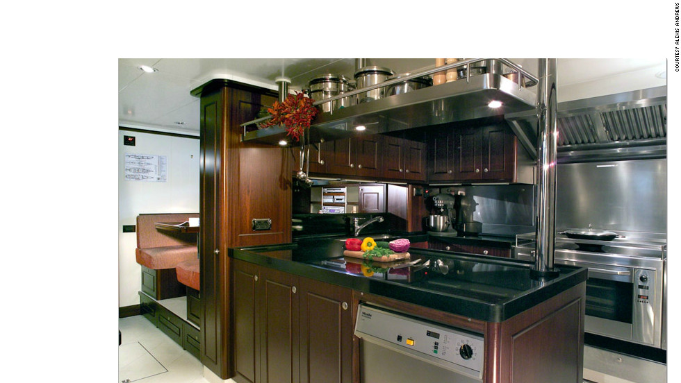 The galley on board 53m superyacht Red Dragon. Each kitchen is specially designed for the high seas with barriers around the hob and latches on cupboards to prevent food from spilling in rough weather.