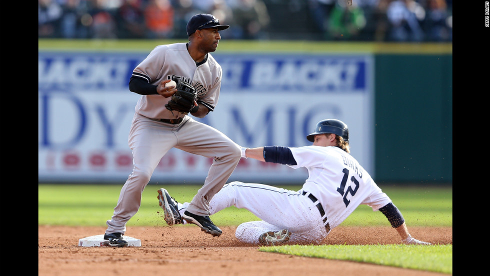 Andy Dirks of the Detroit Tigers is forced out at second base by Eduardo Nunez of the New York Yankees.