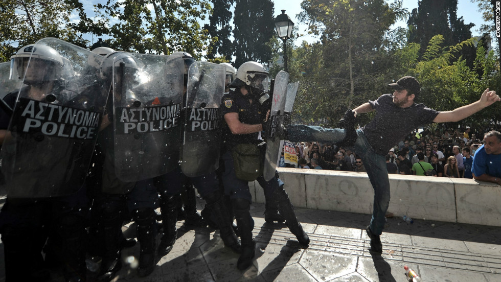 A demonstrator clashes with riot police in Athens.