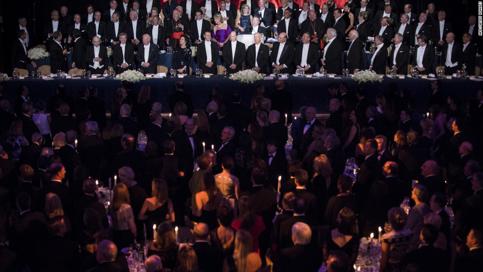 Attendees listen to the national anthem during the 67th annual Al Smith dinner at the Waldorf Astoria hotel in New York on Thursday, October 18. President Barack Obama and Republican presidential candidate Mitt Romney are both attending the fundraiser.