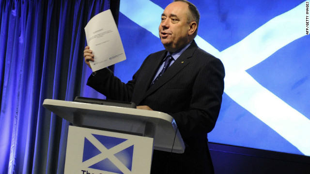 Scotland's First Minister Alex Salmond holds up the signed agreement for a referendum on Scottish independence.