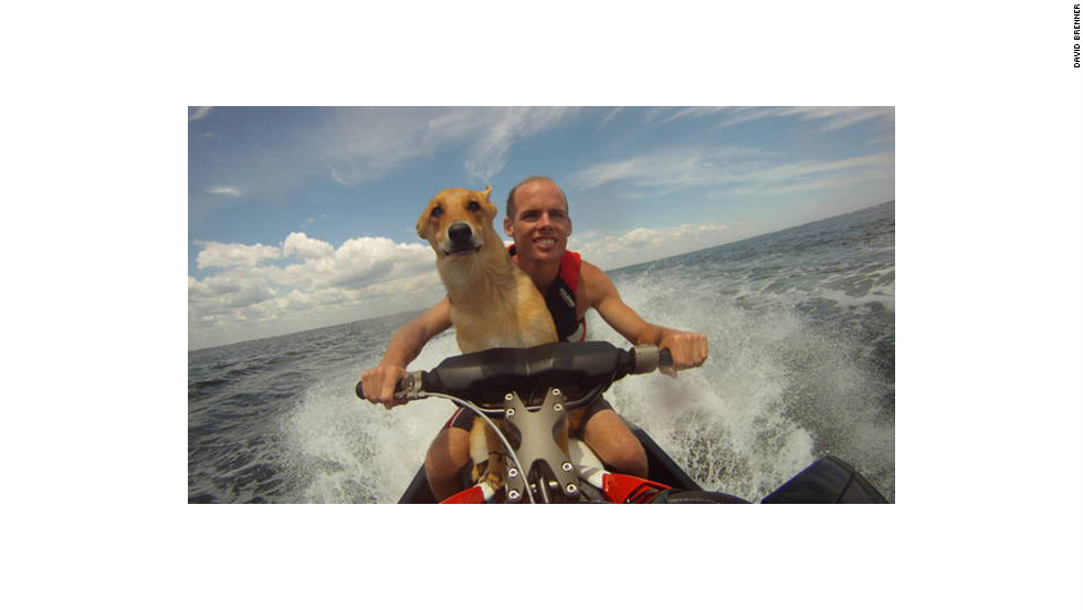 Brian Brenner, with his dog, mounted a camera on the front of his watercraft.