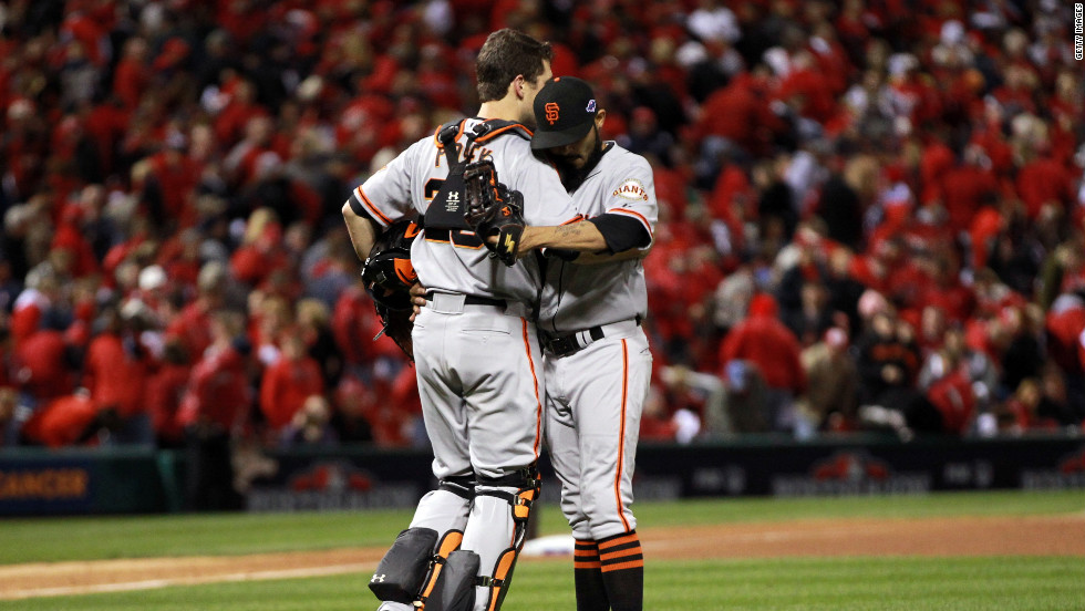 "No.28 Catcher Buster Posey and No. 54 Sergio Romo of the San Francisco Giants celebrate the Giants 5-0 victory over the St. Louis Cardinals in Game 5 of the National League Championship Series at Busch Stadium on October 19, 2012, in St. Louis, Missouri. <a href=""http://www.cnn.com/2012/10/18/worldsport/gallery/nlcs-game-4/index.html"">Look back at Game 4 of the NLCS</a>."