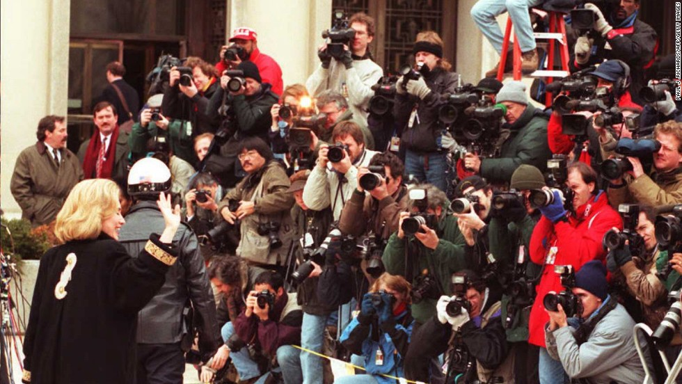 Clinton waves to the media in January 1996 as she arrives for an appearance before a grand jury in Washington. The first lady was subpoenaed to testify as a witness in the investigation of the Whitewater land deal in Arkansas. The Clintons' business investment was investigated, but ultimately they were cleared of any wrongdoing.