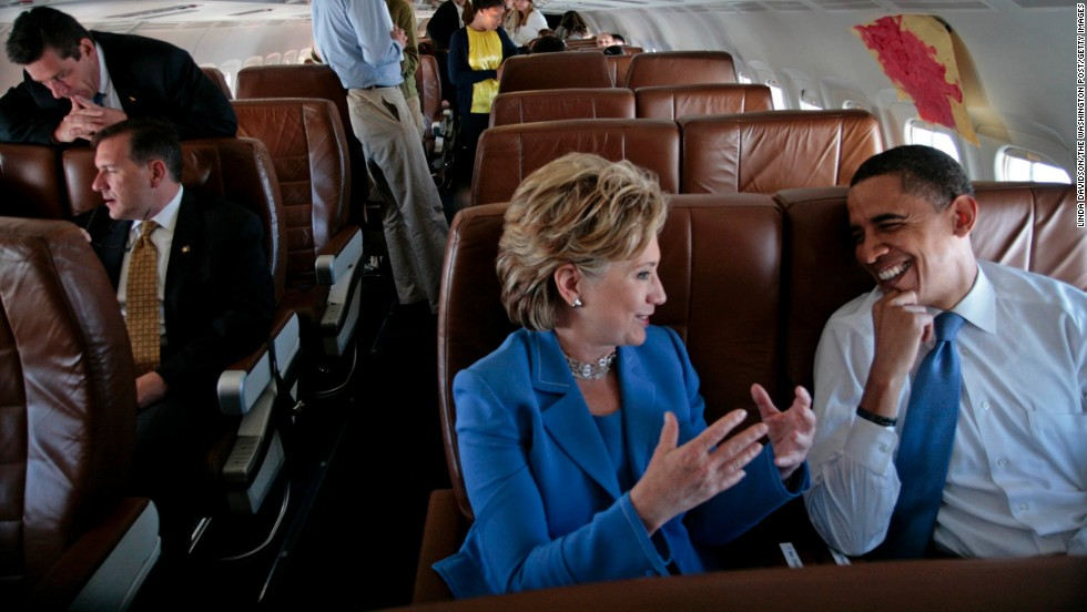 Obama and Clinton talk on the plane on their way to a rally in Unity, New Hampshire, in June 2008. She had recently ended her presidential campaign and endorsed Obama.