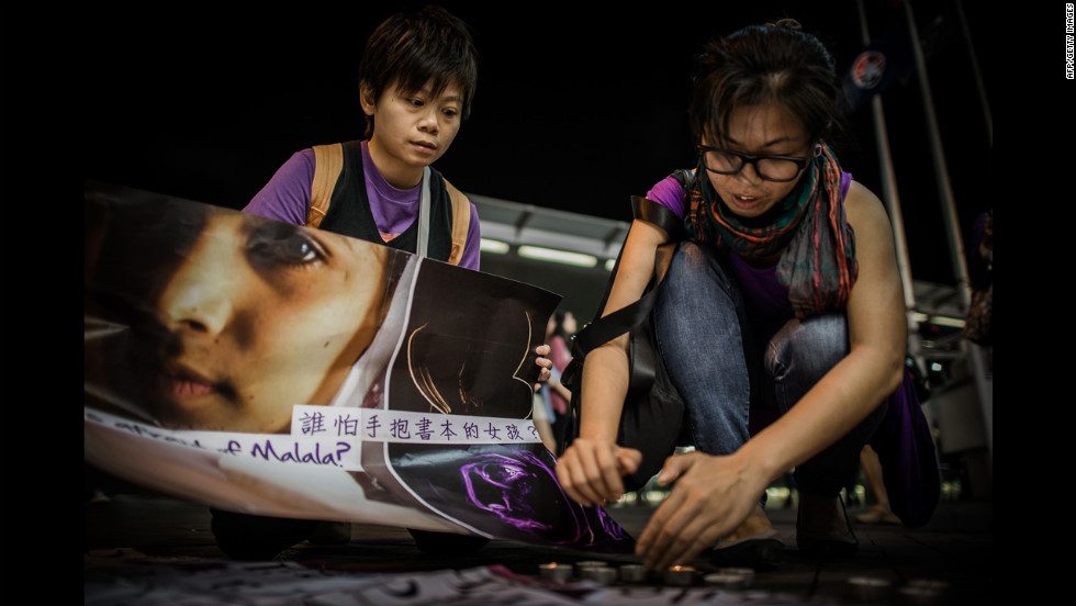 Activists light candles during Friday's vigil in Hong Kong.