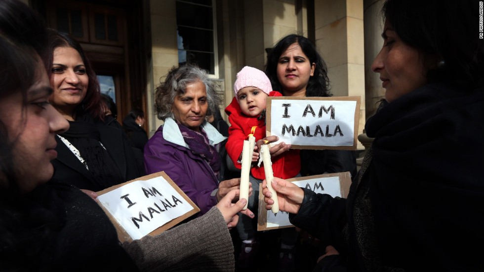 Campaigners gather Friday for a vigil for Malala in Birmingham, England.