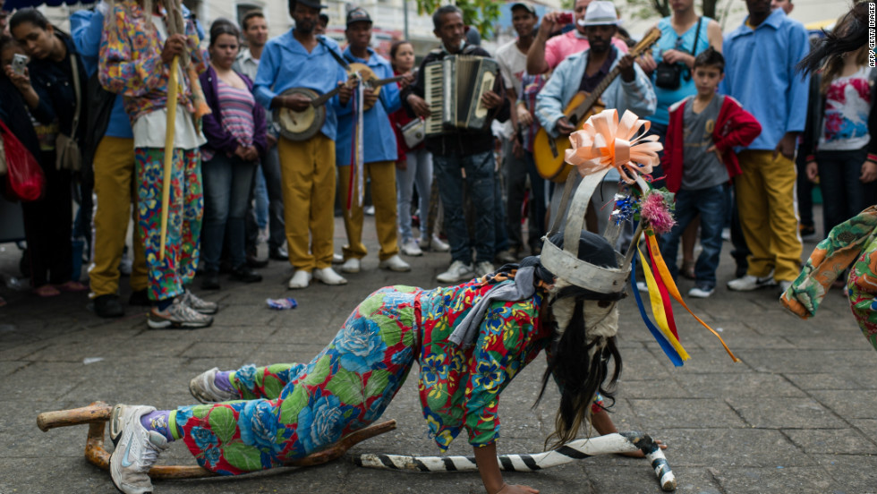 An artist performs in front of the old Basilica of Our Lady of Aparecida in Aparecida during Brazilian patron saint's day. Some people believe that the 39-cm-high teracotta statuette of Our Lady of Aparecida was found by runaway slaves on their way to a quilombo community.