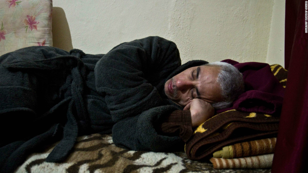 "Fearing for his safety following escalating violence in Syria, ""Bissam"" fled to Turkey. In this image, he's sleeping in his room during his first winter there in January 2012. <br /><br />For Secker, the picture symbolises the very lengthy waiting period associated with the U.N. Refugee Agency's (UNHCR) resettlement program, and the reality of what most of his days were like in winter -- sleeping, using the internet, and sitting in his room.<br /><br />Becca Heller, Director of the Iraqi Refugee Assistance Project (IRAP) based in New York, says that the psychological trauma of being uprooted from social ties to a life spent in hiding and boredom is ""in some ways just as cruel a crime"" as the physical abuse many face back in Iraq."