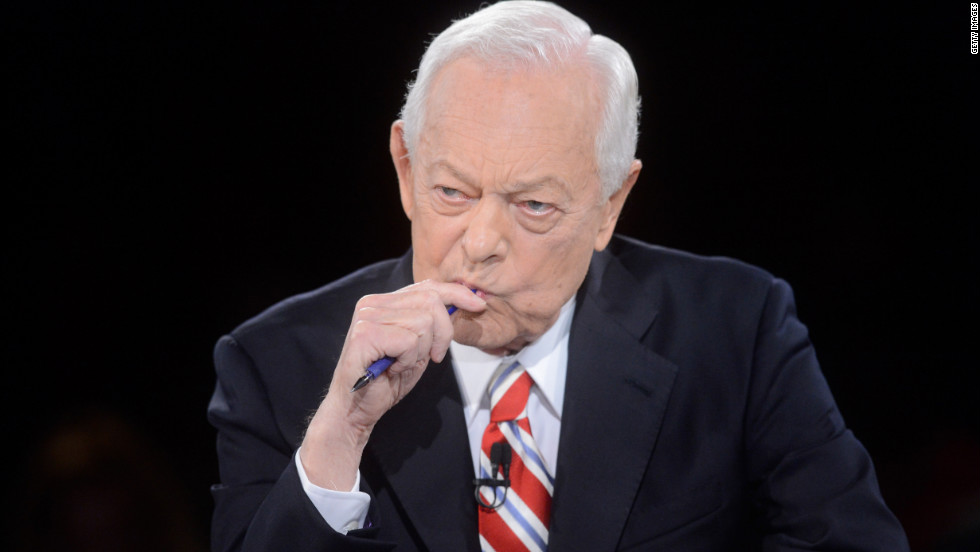 Schieffer listens to the candidates' responses during the debate.