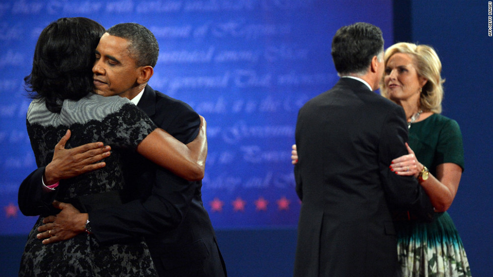 Obama and Romney hug their wives on stage after the debate.