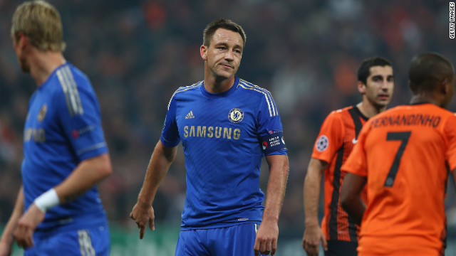 Chelsea suffer their first Champions League defeat since winning the trophy in May, as captain John Terry wears an anti-racism armband a year to the day after racially abusing an opponent in the Premier League.