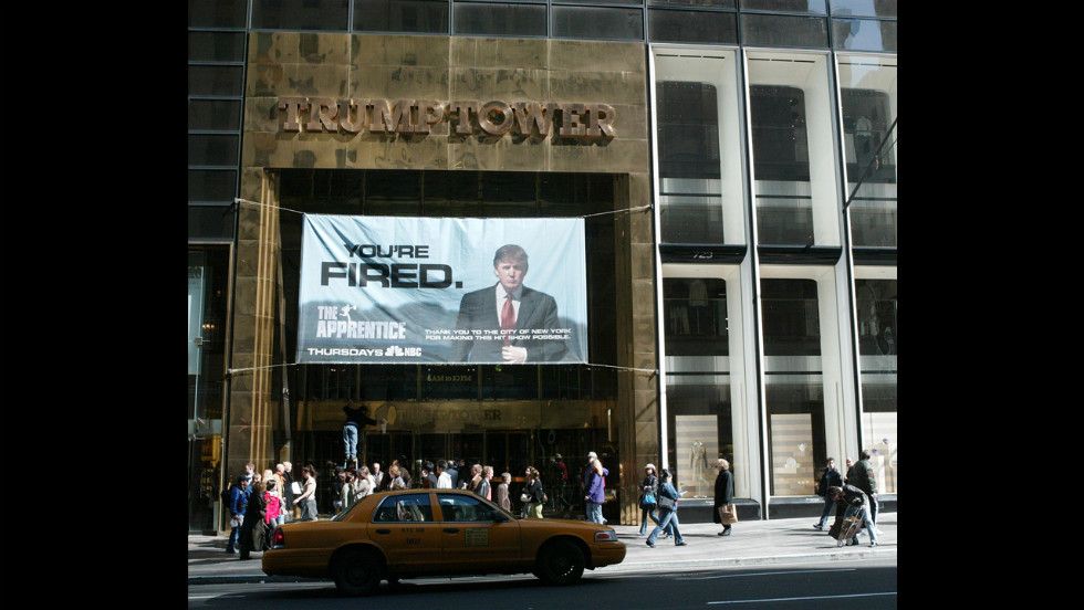 "An advertisement for the television show ""The Apprentice"" hangs at Trump Tower in 2004. The show launched in January of that year. In January 2008, the show returned as ""Celebrity Apprentice."""