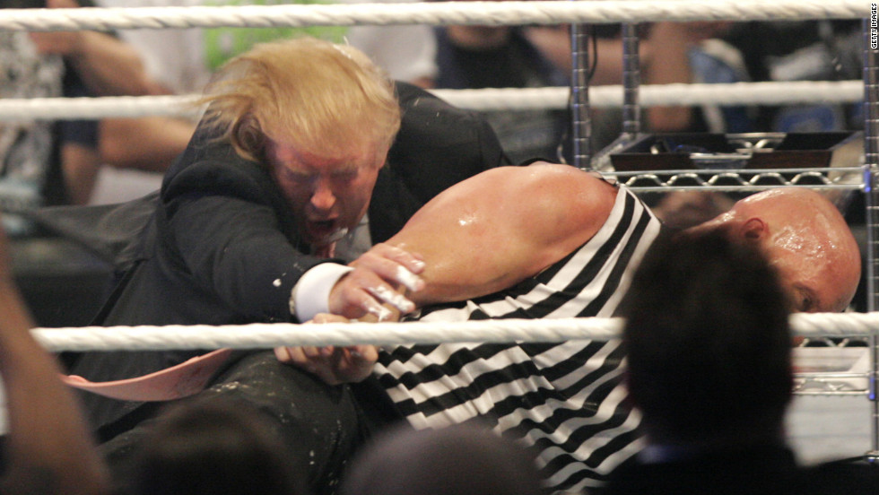 "Trump wrestles with ""Stone Cold"" Steve Austin at WrestleMania in 2007. Trump has close ties with the WWE and its CEO, Vince McMahon."