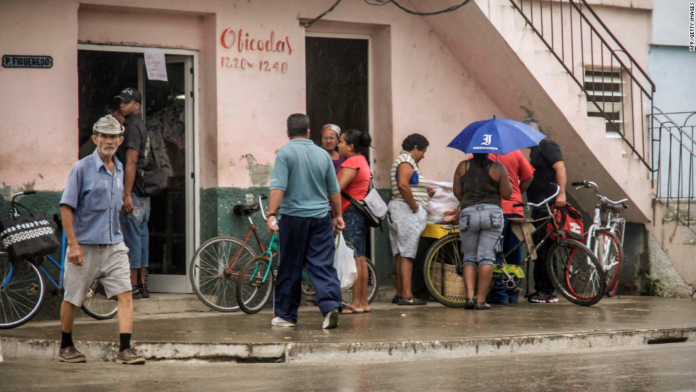 Citizens of Bayamo, Cuba, buy food on  Wednesday, as they prepare for the arrival of Hurricane Sandy.