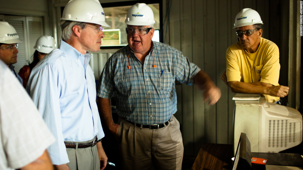 Stephen Worthington, director of Southeast wood procurement at Rayonier, explains to Barrow how the lumber company's technology works. Later, Worthington wondered whether any of Worthington's senior staff would vote for a Democrat.