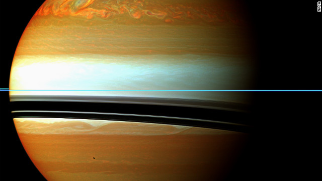 These red, orange and green clouds on Saturn represent the tail end of a 2010/11 massive storm.