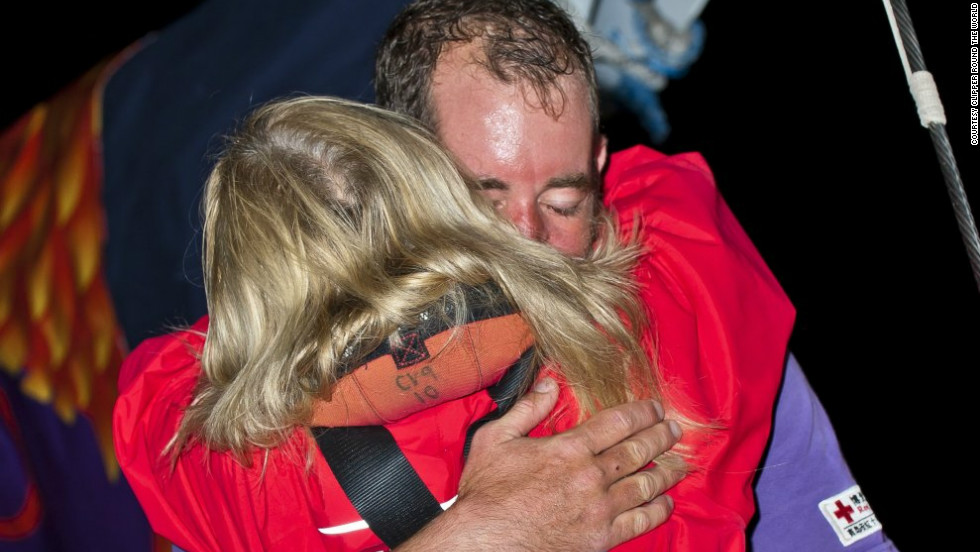 "Qingdao crew members, David Hall and Joanna Sandford, embrace after arriving in Western Australia. ""You learn a lot about the people on board -- it's human interaction on a really deep level,"" said sailor Lisa Blair."
