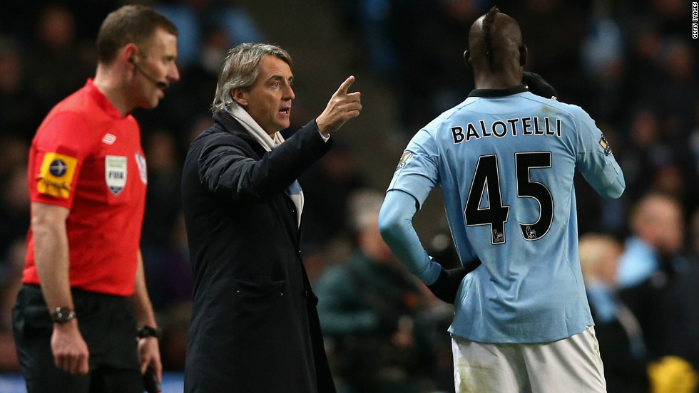 Manchester City manager Roberto Mancini, criticized for his tactics during the midweek Champions League defeat at Ajax, was forced to make a halftime substitution due to an injury to Aleksandar Kolarov. He brought on striker Mario Balotelli.