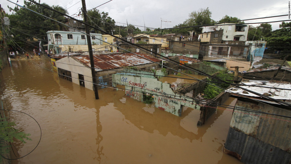 Houses are flooded in the neighborhood of La Javilla in Santo Domingo, the capital of Dominican Republic, on Friday.