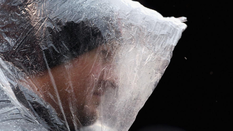 A Cleveland Browns fan braves the wind and rain before their game against the San Diego Chargers in Cleveland on Sunday.