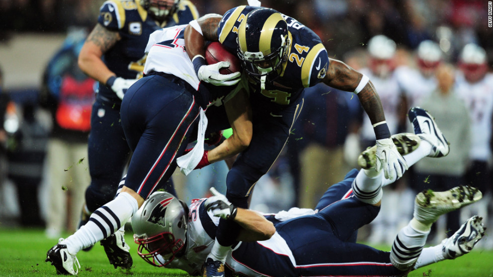New England's No. 11 Julian Edelman and No. 53 Jeff Tarpinian tackle St. Louis' Isaiah Pead on Sunday.