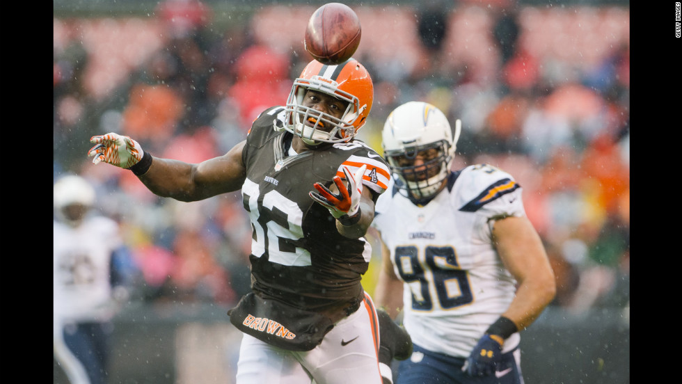 Tight end Benjamin Watson of the Cleveland Browns can't reel in a pass from quarterback Brandon Weeden under pressure from linebacker Antwan Barnes of the San Diego Chargers during the first half at Cleveland Browns Stadium on Sunday, October 28, in Ohio.